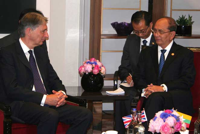 Philip Hammond meeting President Thein Sein, who has stepped up repression of the Rohingya.