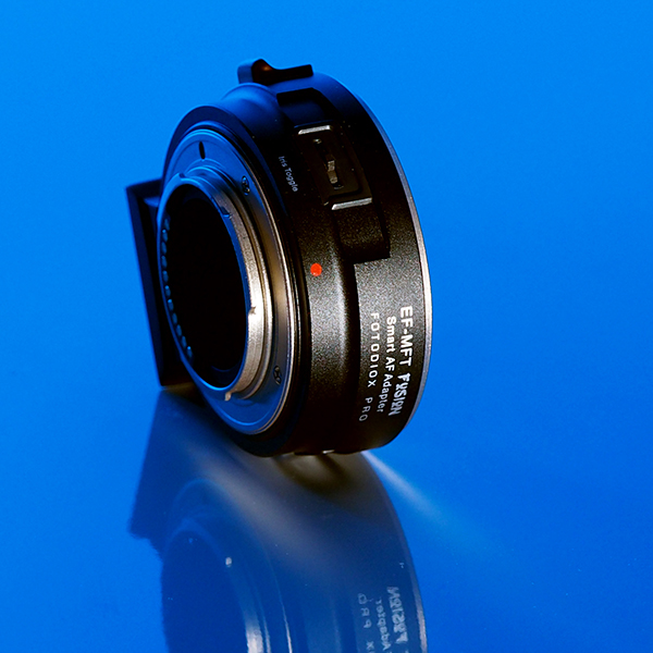 Fusion EF-MFT Smart AF Adapter on Blue Background