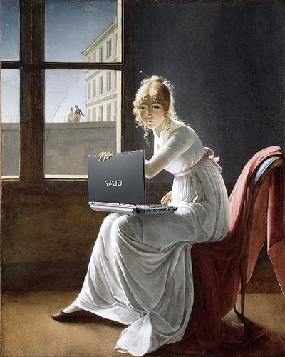 Woman blogging at the window