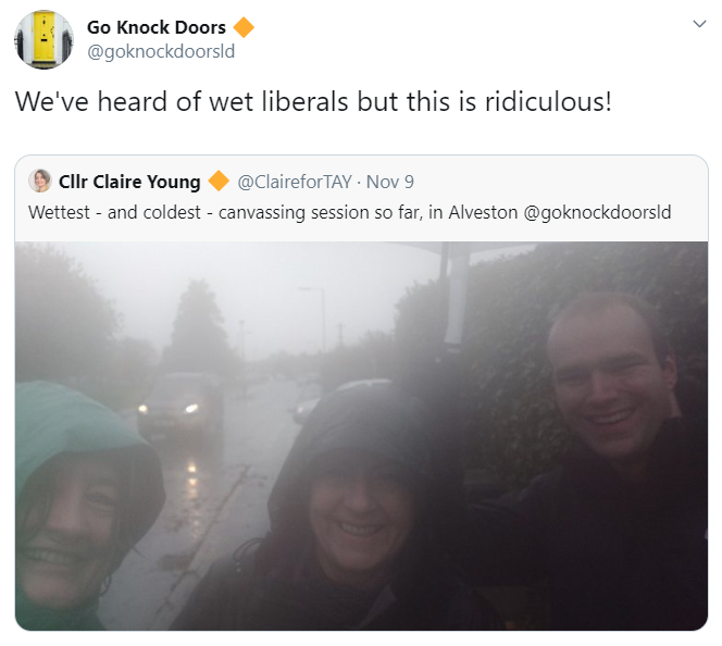 Very wet Lib Dems canvassing in the rain