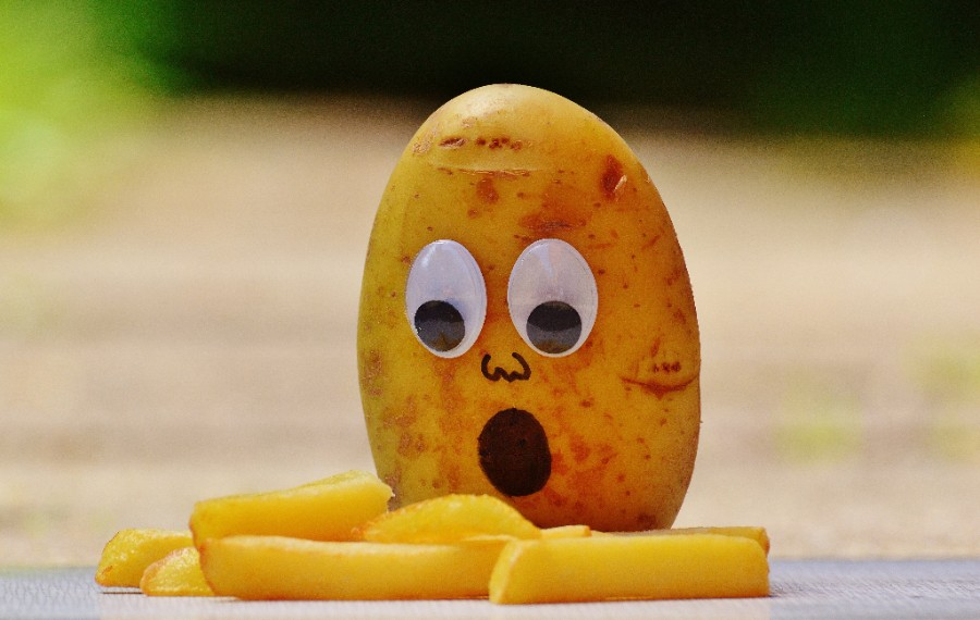 A worried potato looks at some chips