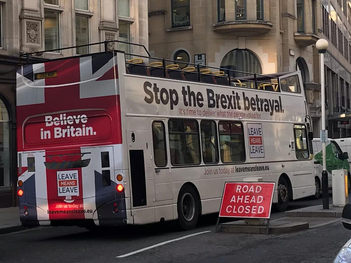 Stop Breixt bus charging past a road closed sign - photo via Asa Bennett on Twitter