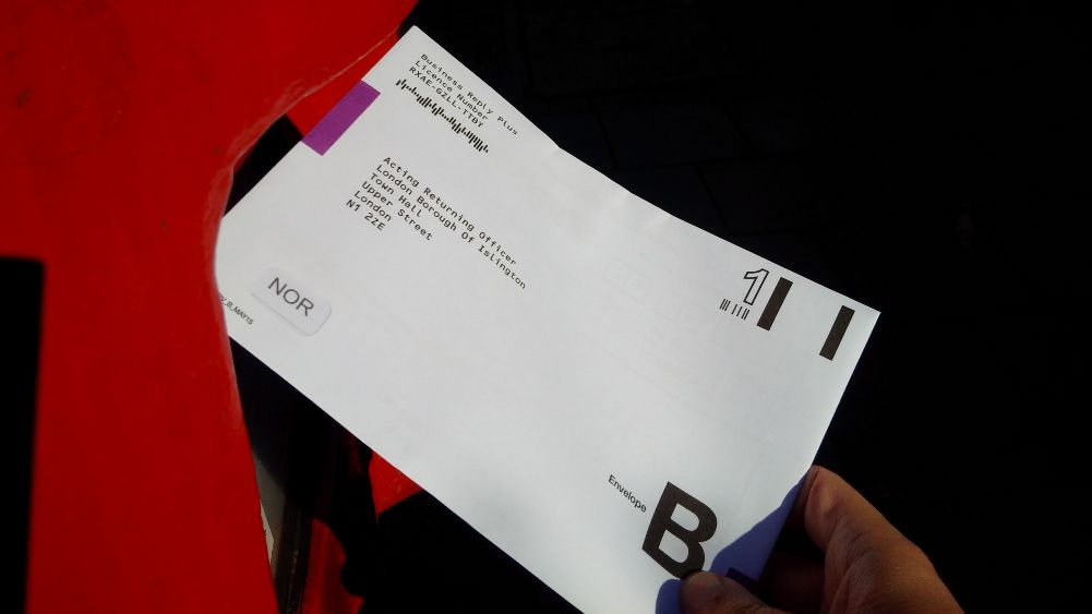 A postal ballot paper being posted