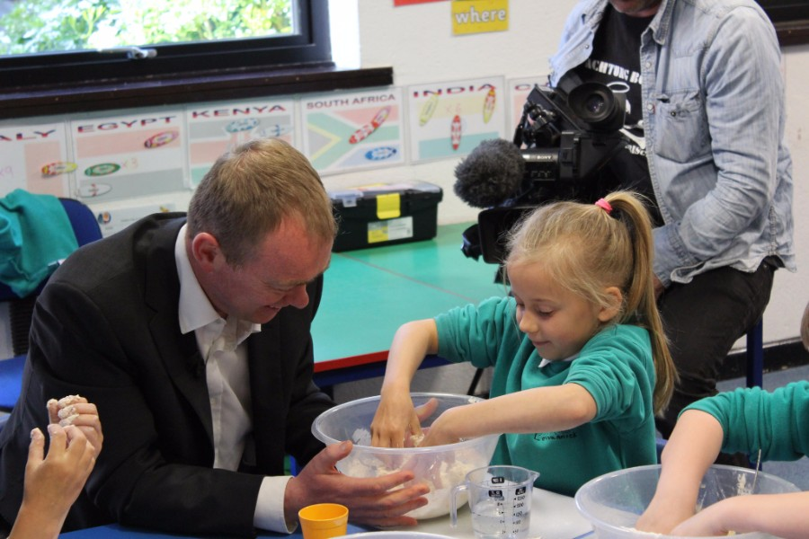 Tim Farron with child on 2017 general election trail - photo courtesy of the Liberal Democrats CC BY-ND 2.0