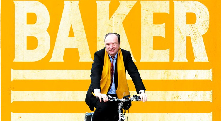 Norman Baker riding a bike