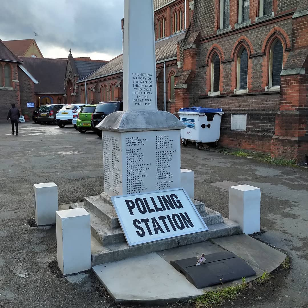 Polling station sign on a war memorial in Watford