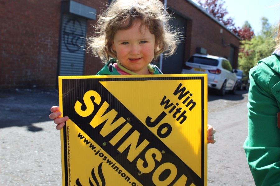Child holding Jo Swinson poster - photo courtesy of the Lib Dems CC BY-ND 2.0