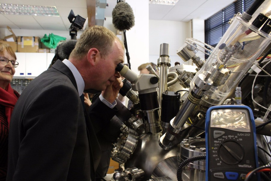 Tim Farron on the 2017 general election campaign trail looking down a microscope - photo courtesy of the Lib Dems CC BY-ND 2.0