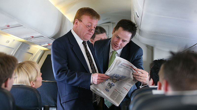 Charles Kennedy and Nick Clegg read the newspapers