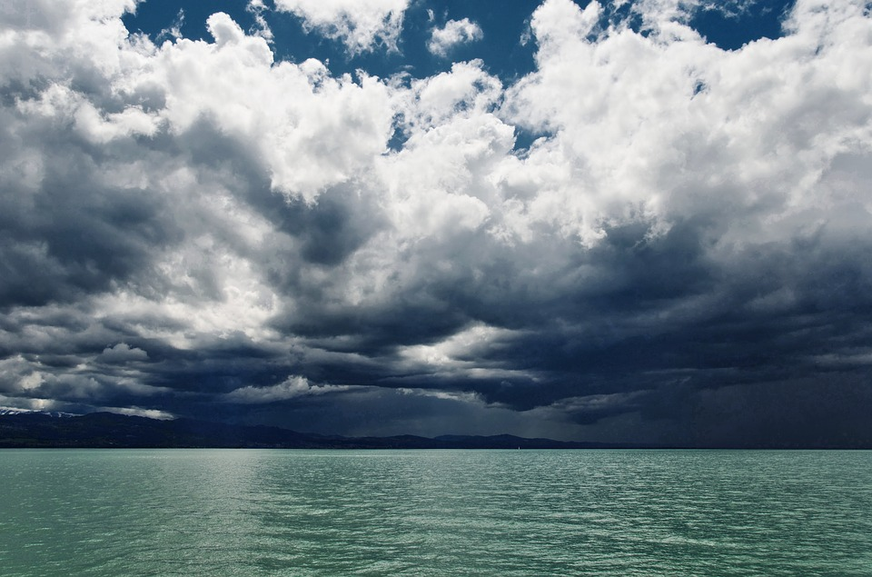 Calm water but a thunderstorm is coming