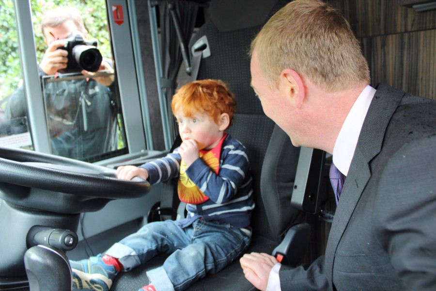Tim Farron with a child in his campaign bus