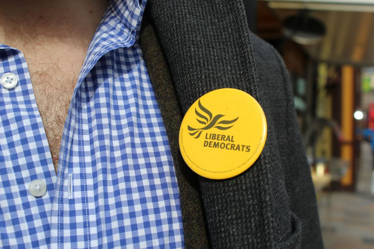 A Lib Dem metal badge on a jacket