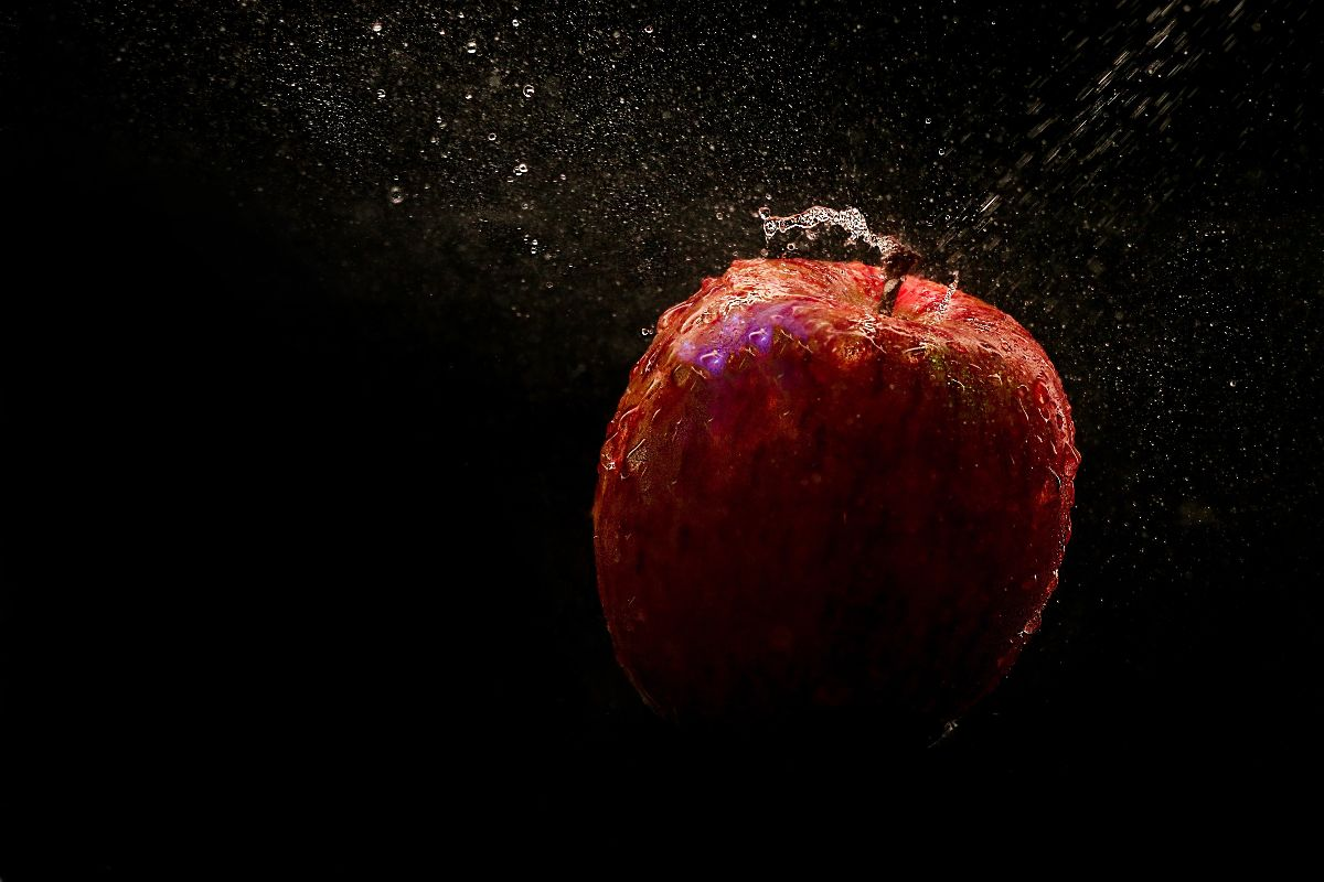A falling apple - photo used under the Pexels license