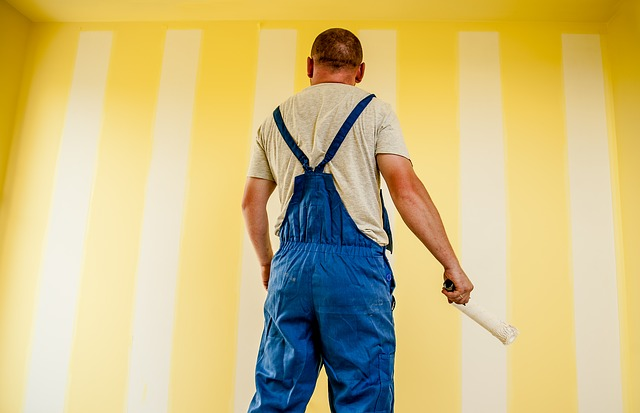 Painting a wall in yellow stripes - CC0 Public Domain