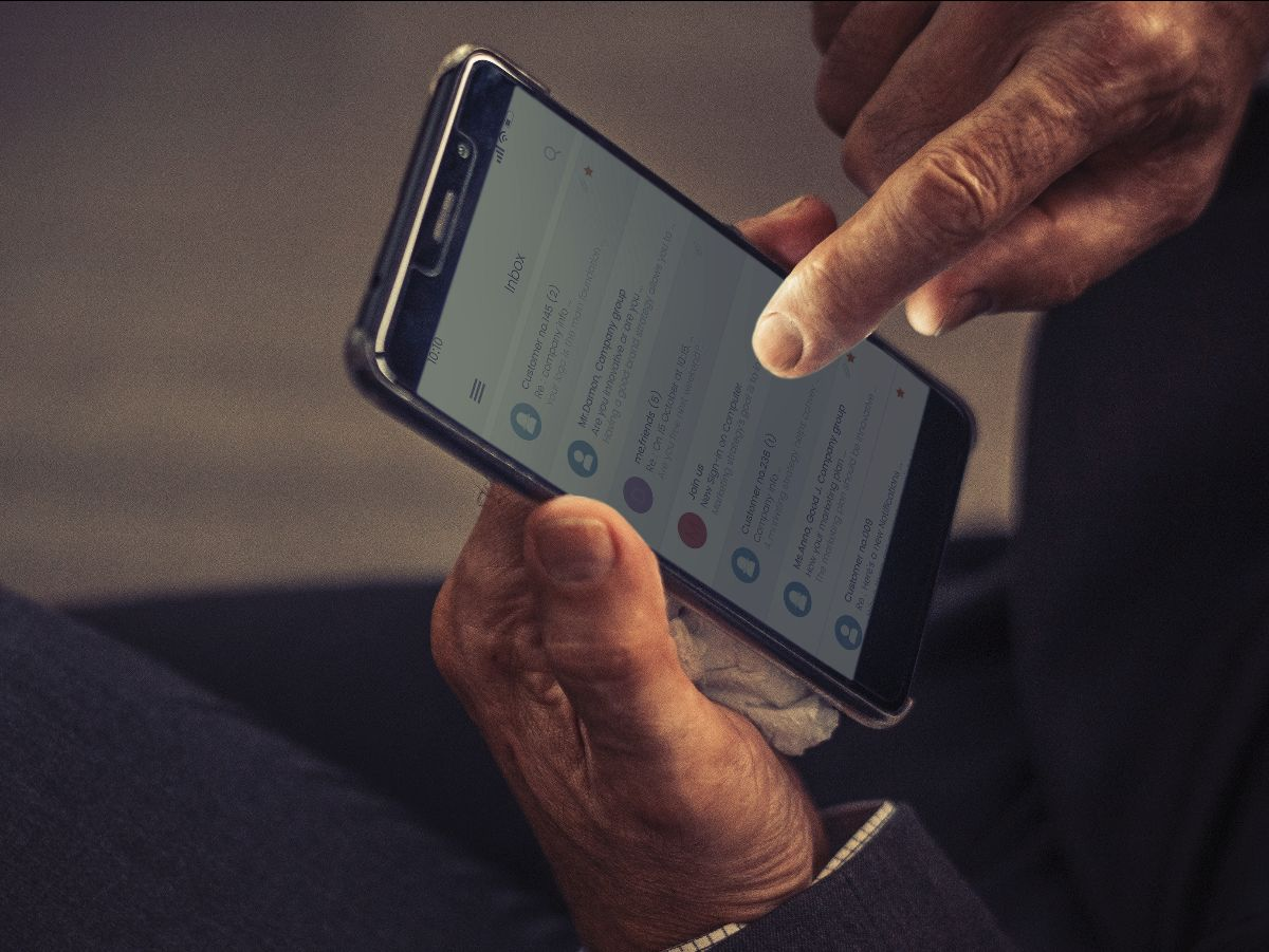 A finger touching the screen of a smartphone