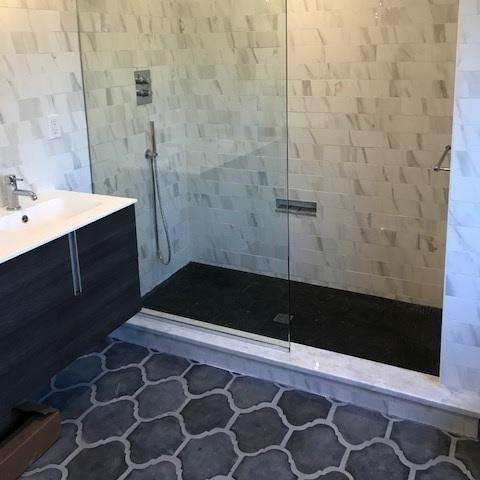 Rustic Cement Floor Tiles Add Warmth to Urban Bath