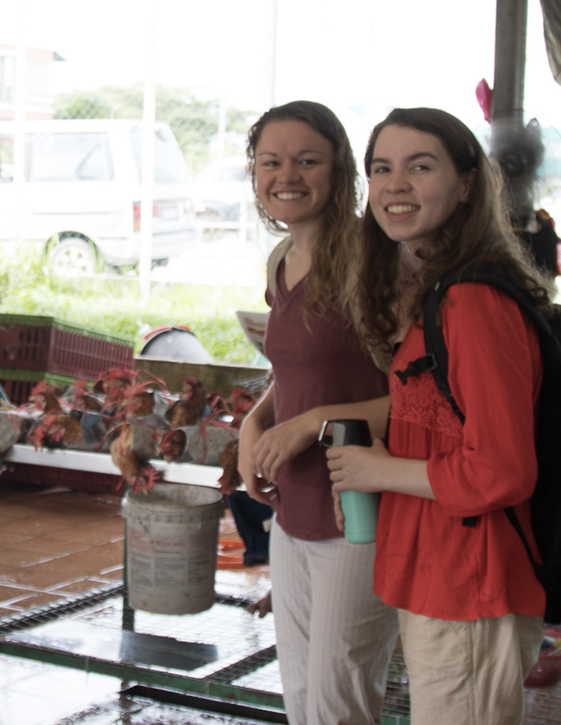 Laura Borkenhagen, MSc (middle), visits an open-air market in Sarawak, Malaysia with two undergraduate students, Rick Tsao (left) and Kerry Mallison (right) for the surveillance study. (PC: Dr. Gregory Gray)