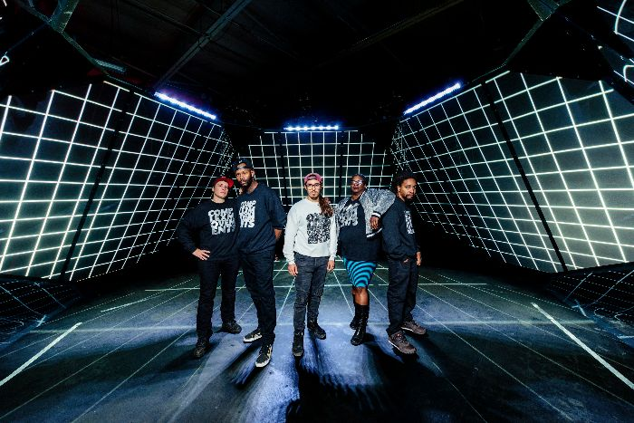 Five people standing in gridded dome: (L to R: ill Weaver/Invincible, Waajeed, L05/Carlos Garcia,_Sage Crump, Wesley Taylor). image credit: Doug Coombe