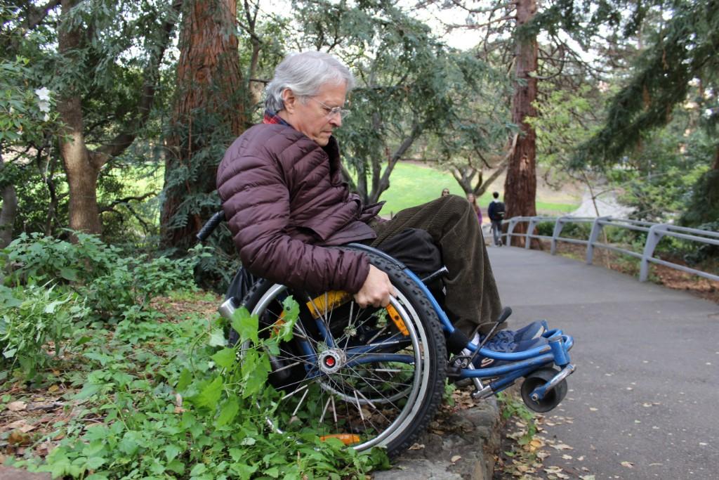 Ralf Hotchkiss balances on the rear wheels of his wheelchair on UC Berkeley campus