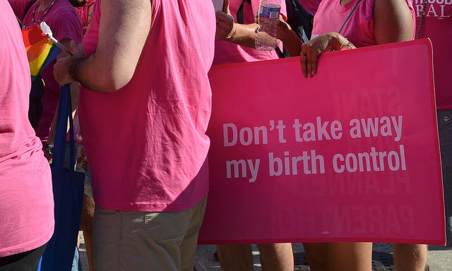 """""""Don't take away my birth control"""" sign held by protestors. Courtesy of ADAM FAGEN / CREATIVE COMMONS VIA FLICKR"""