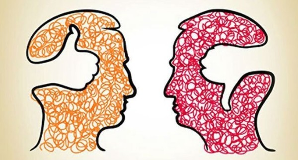 An illustration shows two heads facing each other. One has an outline of a thumbs-up inside its brain. the other had a thumbs down.