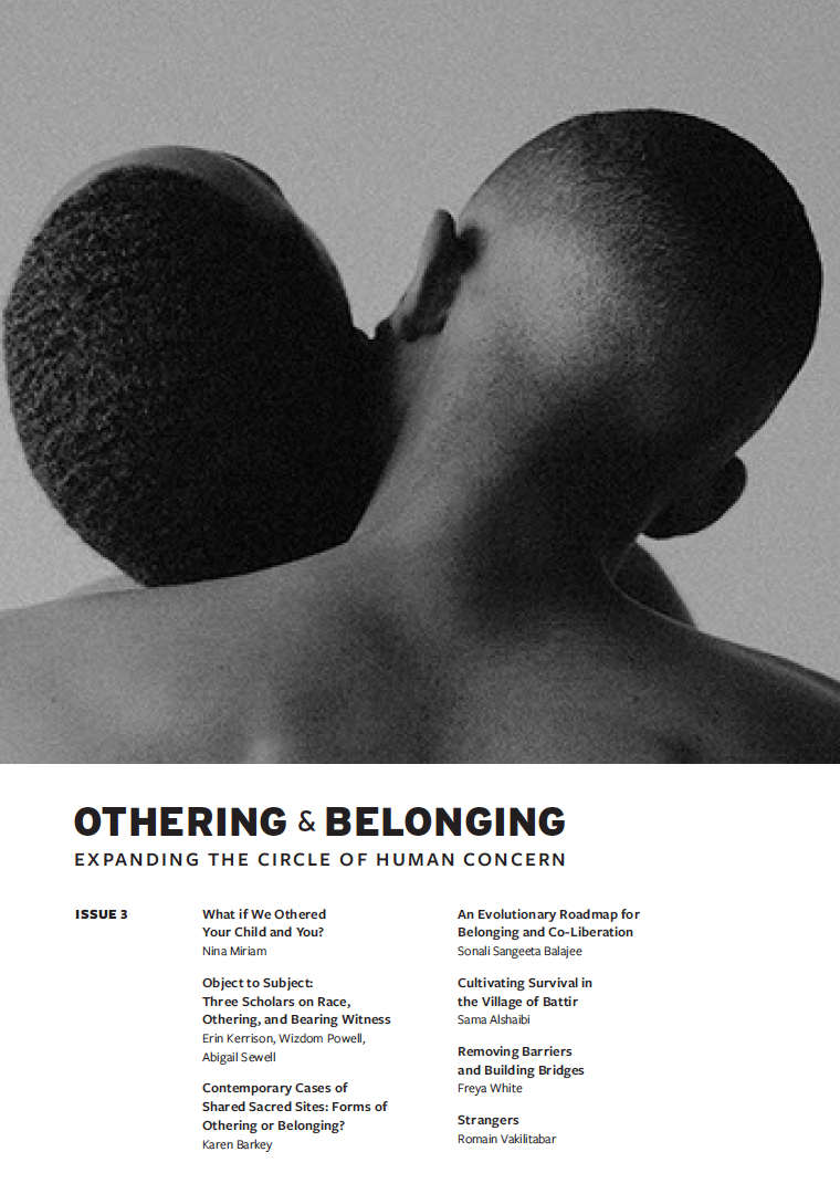 Cover image of Othering & Belonging journal which shows a close up of the back of heads of two Black individuals hugging each other