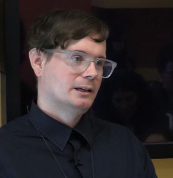 Eric Stanley is pictured giving a talk at UC Berkeley in 2018