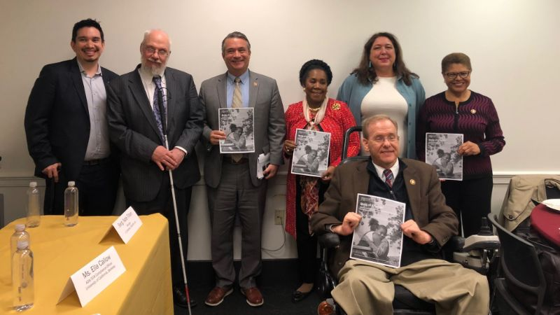 Members of the Congressional Caucus on Foster Youth smiling with State of Change report