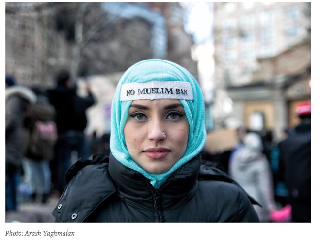 "Image of a woman wearing ""No Muslim Ban"" message"