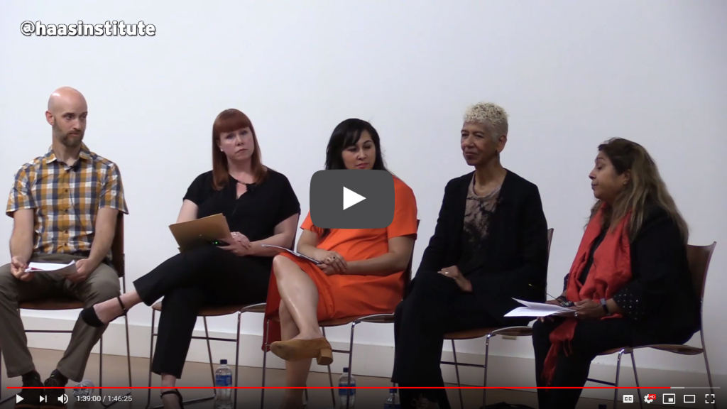 An image grab from the family separations video recording shows the five people who participated in the event seated on stage