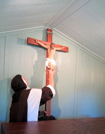 Carmelite Nun, carmelite sister, hanging crucifix, hermitage