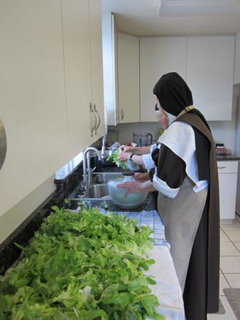 carmelite sister washing lettuce