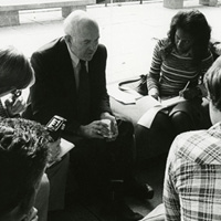 Photo of James Coleman with Students
