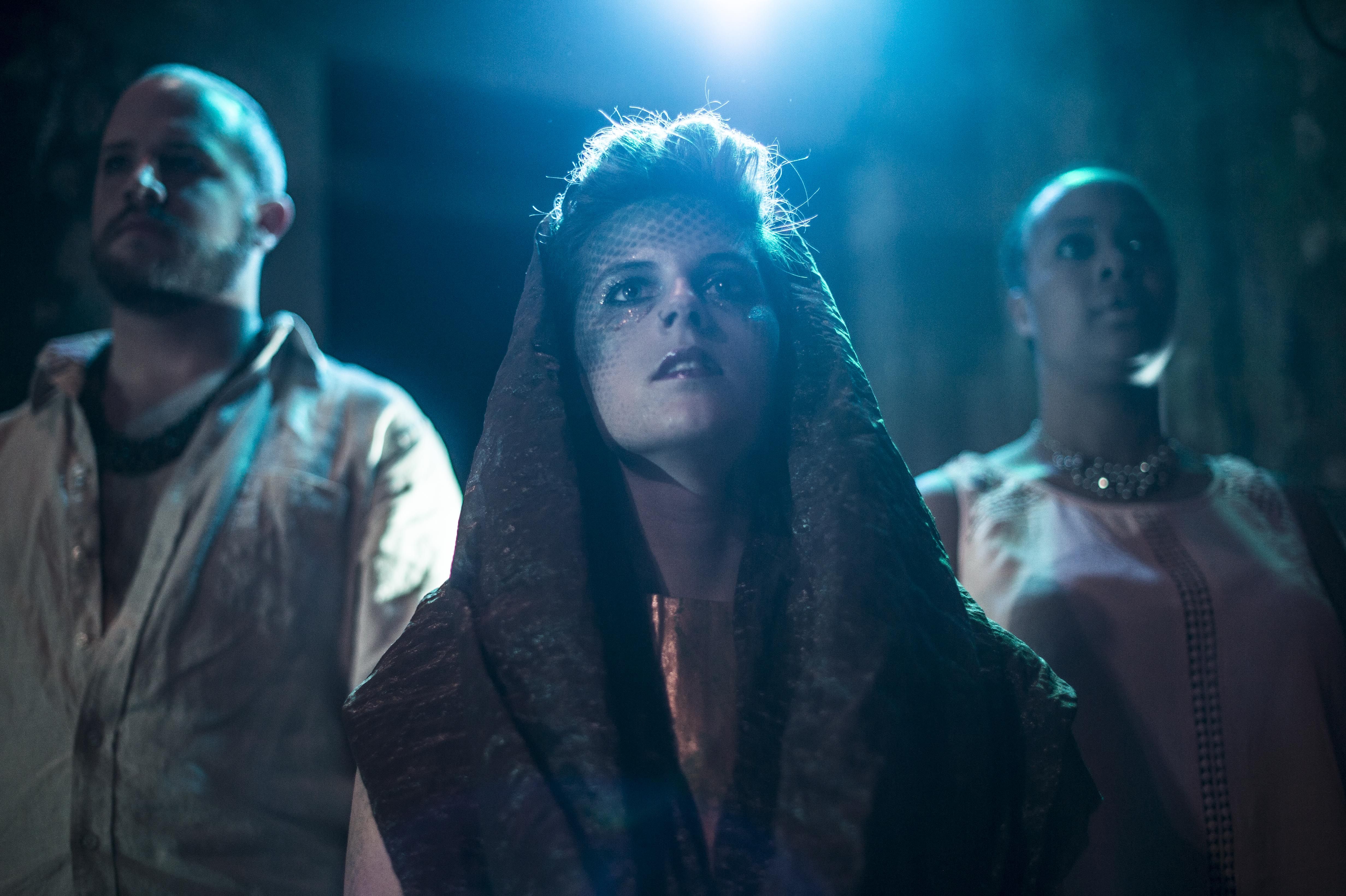 These Are the Men (March/April 2015), Laura Leffler-McCabe as Jocasta, Michael Ooms as Creon, surrounded by the ensemble. Photo credit: Carl Atiya Swanson