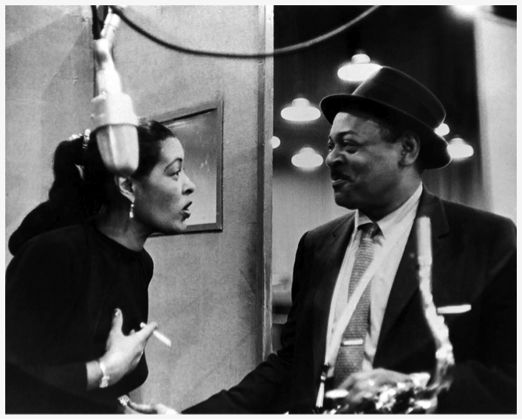 Black and white photograph of Billie Holiday (left) and Coleman Hawkins (right).