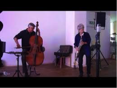 Photograph of Wilbert de Joode (bass) with Lori Freedman (clarinet).