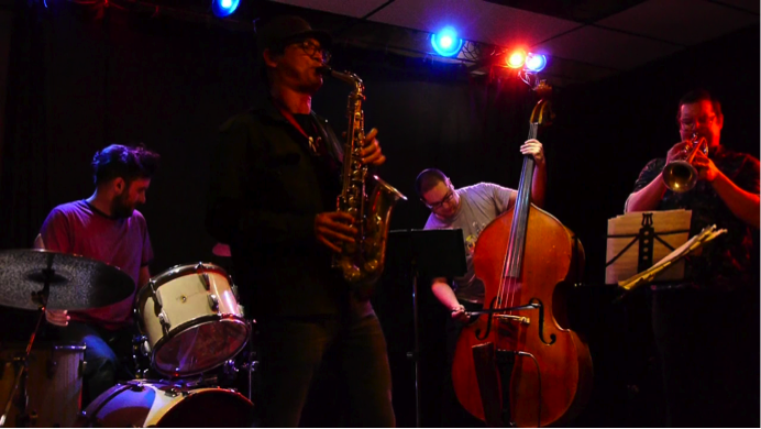 Photograph of the Craig Pedersen Quartet playing at Artword Artbar in Hamilton, Ontario.