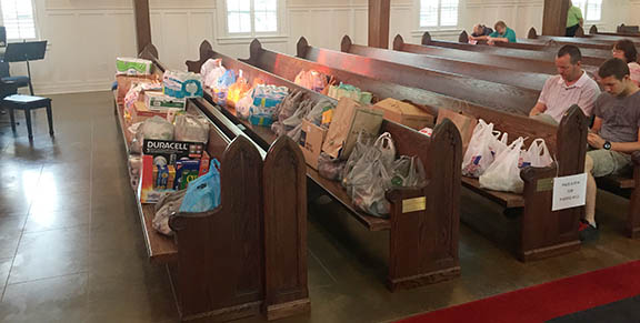 Pews filled with hurricane relief supplies