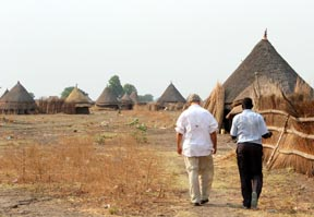 Bishop Grant LeMarquand walking with priest in village
