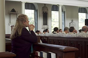 Anna Smith praying during the clergy renewal of vows service.