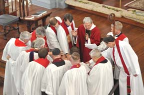 The Rev. Jonathan Bennett is prayed for during his ordination