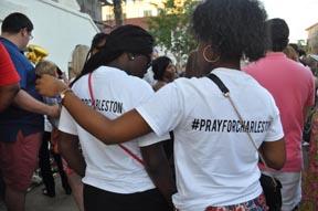 "Women with ""#Pray for Charleston"" shirts"