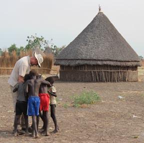 Ethiopian children gather around guest