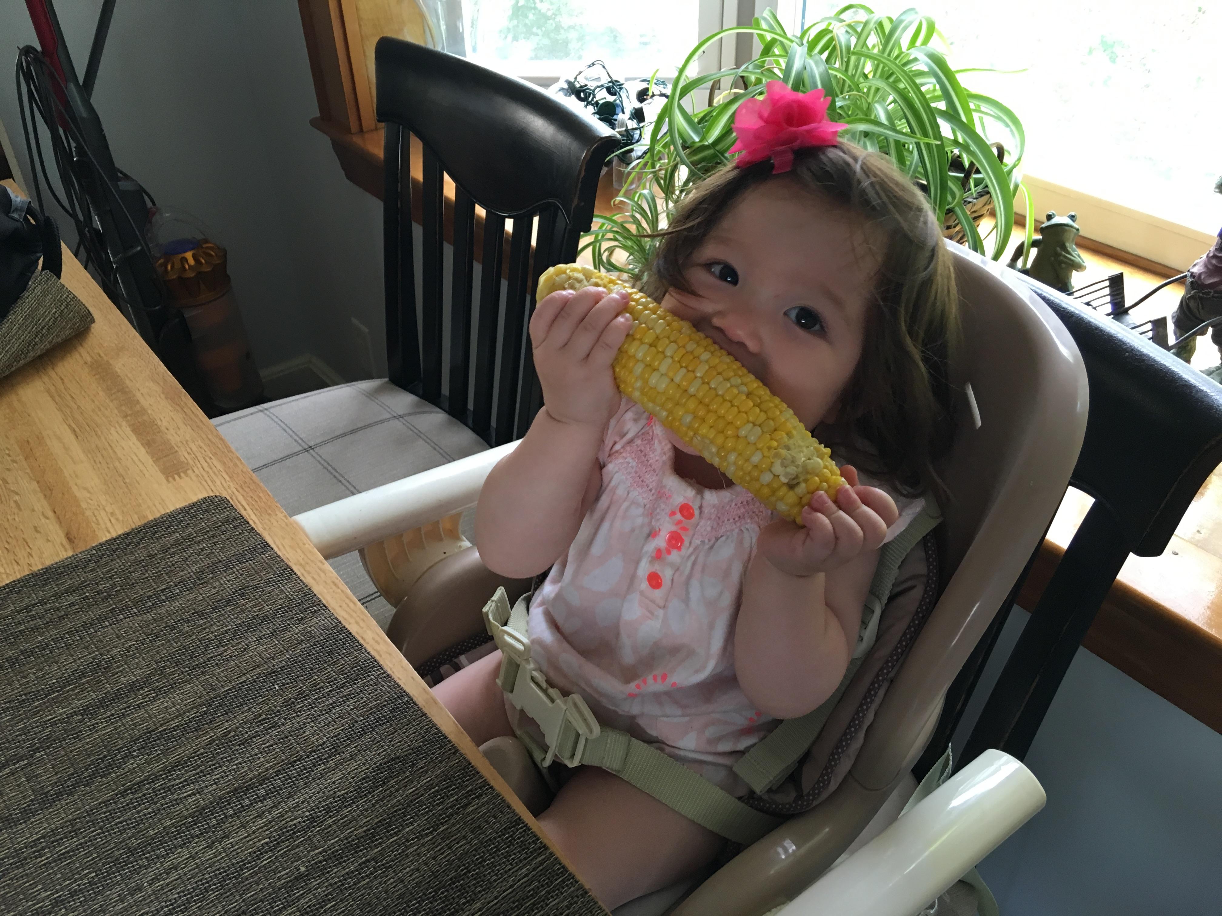 Kimi eating corn
