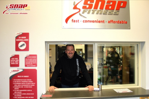 Smiling face at Snap Fitness welcoming members to the club.