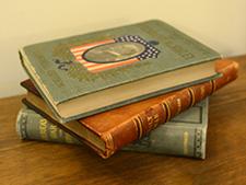 Three books donated by Mr. Helper