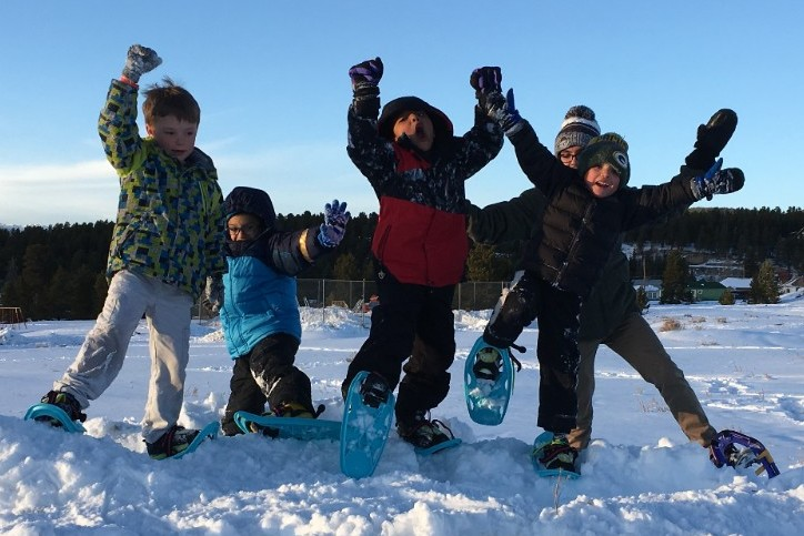 West Park Elementary afterschool Adventure Club students romp on snowshoes
