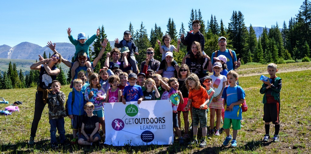 Rockies Rock campers celebrate their hike up Ball Mountain