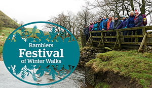 A group of people on a bridge beside a graphic of the Ramblers Festival of Winter Walks logo