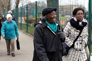 Three older women walking in an urban location